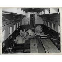 1941 Press Photo Aircraft workers strip down cabin of Douglas flagship