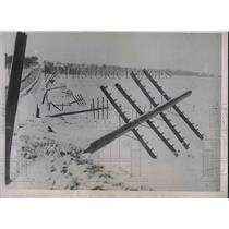 1935 Press Photo Power lines destroyed in the Minnesota blizzard.