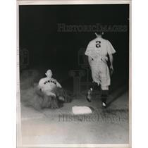 1938 Press Photo Les Scarsella, Newark Bears, slides into third base