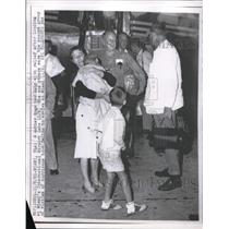 1961 Press Photo mom hugs her baby after landing at Miami International Airport