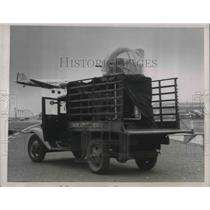 1937 Press Photo Cannon on Truck as Plane Passes