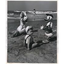 1955 Press Photo Boy Watched by Life Size Disney Replicas in Ostia, Italy
