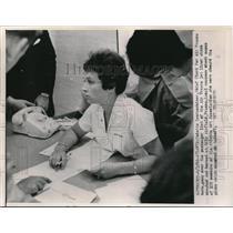 1962 Press Photo Atlanta, Ga C Lawzenhiser checks names of plane crash victims