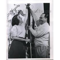 Press Photo Woman Buying Skis