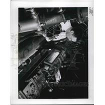 1957 Press Photo NACA Research labs, Lewis engineer tests combustion engine
