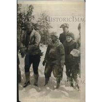 1924 Press Photo A group of children & a man playing in the snow