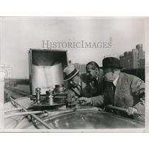 1931 Press Photo NYC Health Department Heads Inspect Valves On New Milk Train