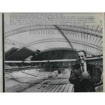 1971 Press Photo Bert Rose stands high inside the Dallas Cowboys stadium.