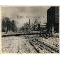 1924 Press Photo Fallen Telephone Pole In Snowy Icy Winter Scene