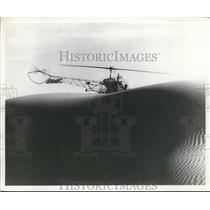 1960 Press Photo Futuristic Bell Helicopter Flies Over Sand Dunes - nec53000