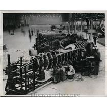 1937 Press Photo Men assembling fuselages of Planes at Austin Factory.