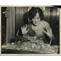 1930 Press Photo Starlet Emily Walters holding trophy to be presented to the