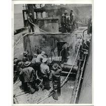 1942 Press Photo Naval Fire Fighters Large Oil Tanker Struck Mine - nec68115