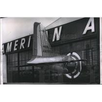 1955 Press Photo Tail Of DC-6B Stick Out Of Byrne Doors