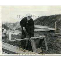 1928 Press Photo Francis Hogan, catcher of Giants saws wood at his home