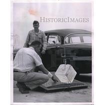 1956 Press Photo Engineers JR Phillips, CD Birmingham test plane landing gears