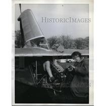 1961 Press Photo Anne Marsden Secures Derek Piggot's Feet To Pedals For Test