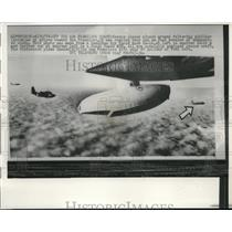 1958 Press Photo Rescue planes flying close to the low fuel liner