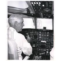 1962 Press Photo Merrill C. Meigs at the controls of the Lockheed JetStar.