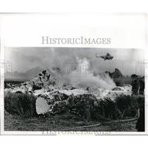 1965 Press Photo Helicopter hovering over wreckage of A Royal Air Force Plane