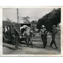 1941 Press Photo Drafters on their way home after a day of work in Patapsco MD