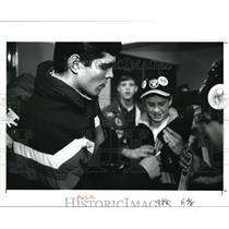 1991 Press Photo Soviet hockey player Sergei Bushmelev signs the hockey stick
