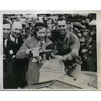 1934 Press Photo Mr. and Mrs. C.J.P. Dodson drink champagne after he won a race