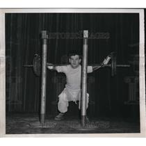 1948 Press Photo John Noval lifting 160 Lbs at a competition in Cleveland.