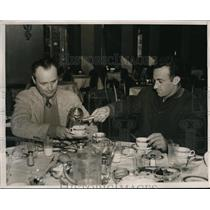 1938 Press Photo Edward Adican Pours Tea For The Coach At Lunch