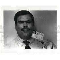 1987 Press Photo Pilot Robert Kimrey with his ID card