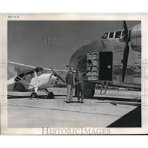 1946 Press Photo Giant C-12 Packet Cargo Plane with Chief Pilot Dick Henson.