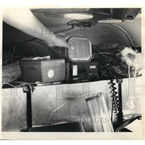 1971 Press Photo Mrs. Hendrix point out plane tiny radio with jam packed Seat.