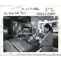 1990 Press Photo Debby Fields helps customer Princene Boyd select from offerings