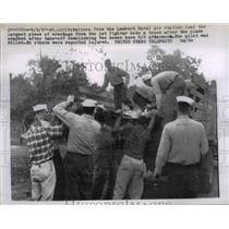 1957 Press Photo Sailors from Lambert Naval Air Station with a jet wreckage