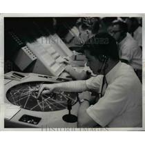 1964 Press Photo Worker Tracing Aircraft Position on Complex Equipment