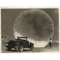 1926 Press Photo of a ground parachute test.