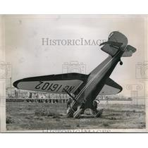 1938 Press Photo of Roy Arthur Ellis and his plane after a forced landing.