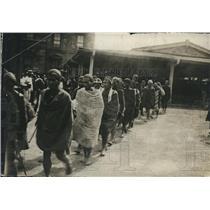 1912 Vintage Press Photo line of men walking in Japan - nez17561