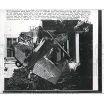 1957 Press Photo Wreckage of light plane embedded in Farmhouse