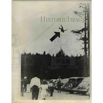 1941 Press Photo Don Nixon Hurtlign through Air After Losing Balance off Wire