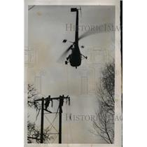 1952 Press Photo Helicopter Lays Power Cable Line, England