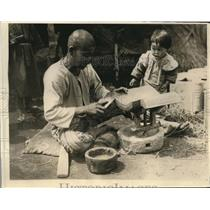 1919 Press Photo Japanese tile factory worker & owners baby at the plant