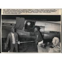 1972 Press Photo Nassau Airport workers loading furniture at the C46 cargo plane