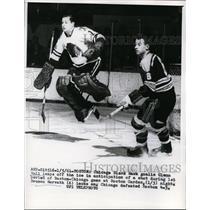 1961 Press Photo Chicago Black Hawk goalie Glenn Hall leaps off ice - nes31349