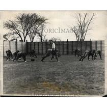 1926 Press Photo Asst. Coach Mal Greenough works his Harvard football squad