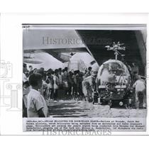 1961 Wire Photo The natives of Merauko watch the helicopter being unloaded