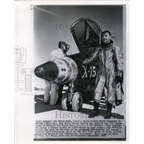 1961 Wire Photo Maj. Bob White stands beside the nose of the x15 rocket plane