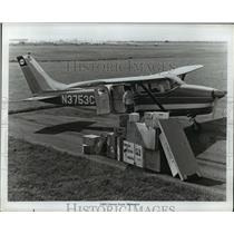 1955 Press Photo Cessna Plane Being Loaded with Packages - nex95880