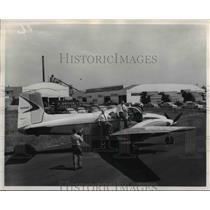 1956 Press Photo Bob, Tony and Ed Dwyer board their Beechcraft Twin Bonanza