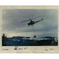 1987 Press Photo Fertilizer for the trees in the Mount Hood National Forest.